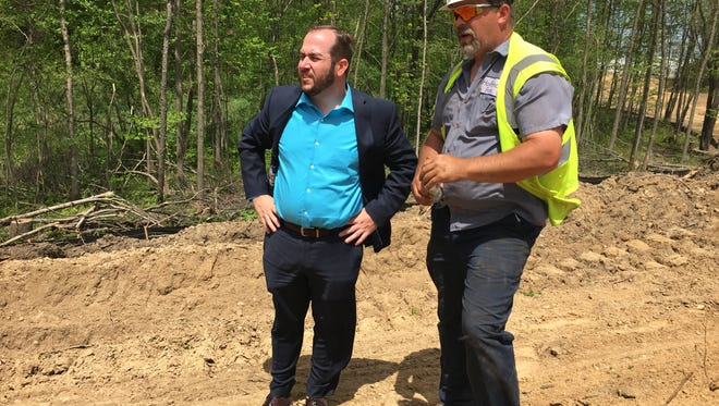 Battle Creek Unlimited President and CEO Joe Sobieralski (left) and Hoffman Bros. project lead Neal Elliott stand near future development-ready sites within Battle Creek's Fort Custer Industrial Park.