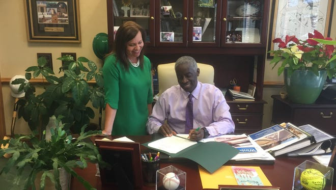 United Way's Teen Pregnancy Prevention Coordinator April Cameron joined Mayor Terence Roberts as he signed a proclamation
