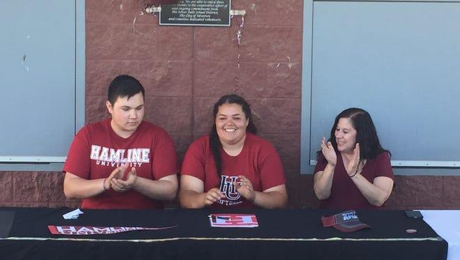 Silverton senior Alex Molloy (center) signed to play softball at Hamline University on Tuesday, May 23, 2017.