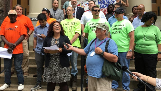 Construction workers, labor leaders and Metro Nashville council members call for better working conditions in the construction industry at a news conference Tuesday in downtown Nashville.