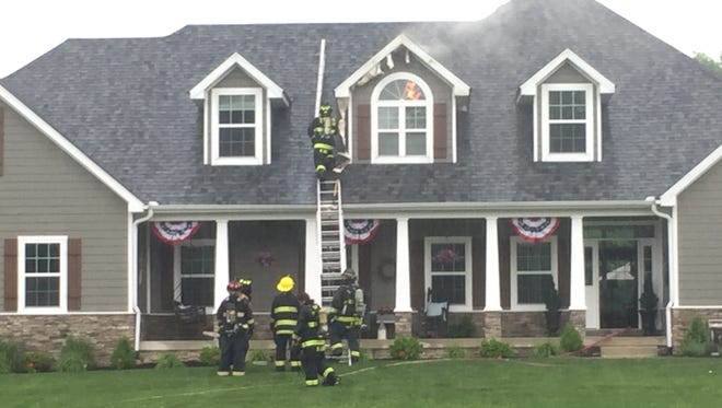 Firefighters respond to a house fire in Delaware County on Wednesday, May 24, 2017.