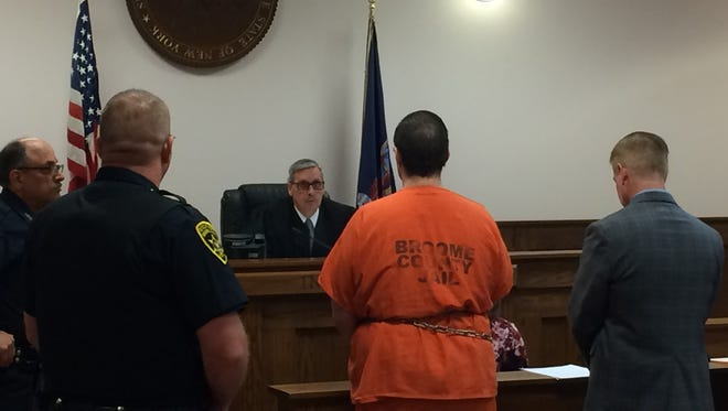 A shackled Kenneth Weber pleads guilty to first-degree manslaughter in the death of his grandmother Saundra Stabler.