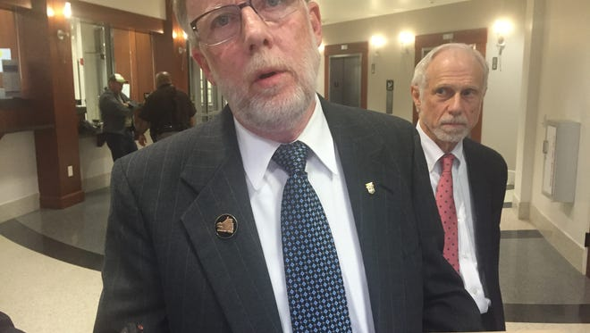 Bill Londrigan, president of the Kentucky AFL-CIO at Franklin County courthouse. In background is Irwin Cutler, attorney for the AFL-CIO.