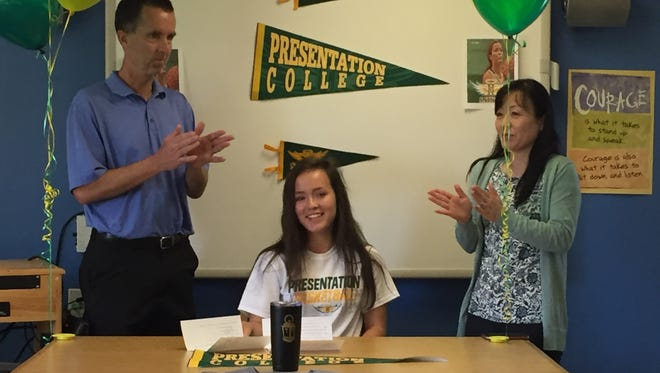 Blanchet senior Sophia Poole (center) signed a letter of intent to play basketball at Presentation College on Thursday, May 25, 2017.