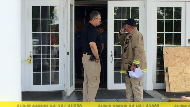 Dickson County Sheriff Jeff Bledsoe talks to Scotty Harrell with nearby Tennessee City Volunteer Fire Department at the scene of the structure collapse inside Westgate Church in Dickson.