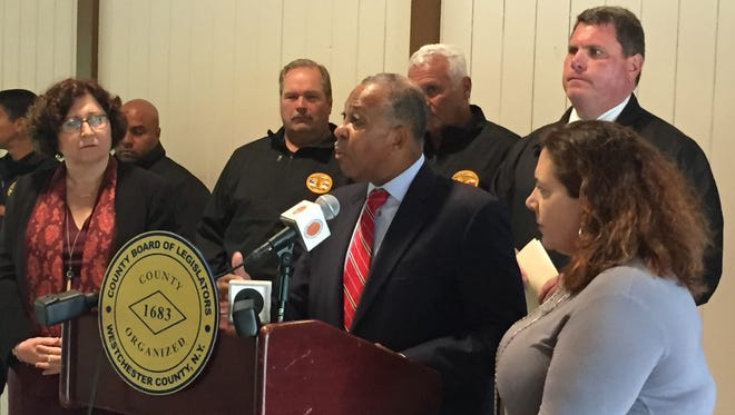 Legislators Ben Boykin (at podium), Mary Jane Shimsky and Catherine Borgia were joined by county police union members at a news conference Thursday at Willson's Woods Park calling for the hiring of more officers.