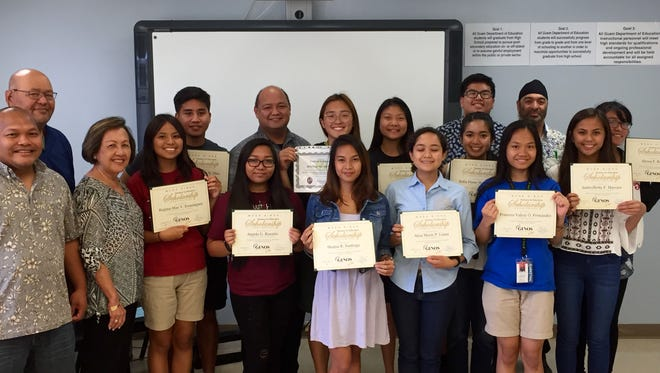 Education Superintendent Jon Fernandez and Guam Department of Education school principals join most of the 13 college-bound seniors who received scholarship awards from Moda Gino's and the Society of American Military Engineers Guam Post, Friday afternoon.