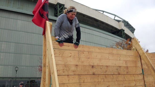 Lori Nickel participates in the Spartan race at Miller Park in 2014.
