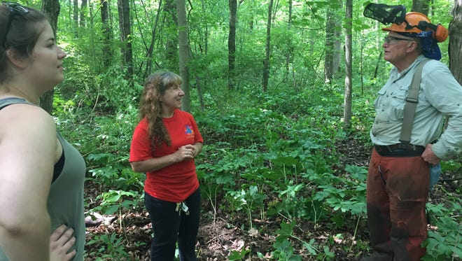 Zonda Bryant, center, talks with Jessica Berry and Bill Hoover about work to do in an 18.8-acre forest the nonprofit group Hands of the Future is hoping to buy on the edge of West Lafayette.