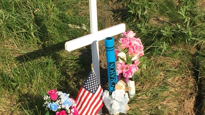 A memorial set up Tuesday at the site along the Muncie Bypass where 6-year-old Taelyn Ann Marie Woodson was killed in a crash of her family's van on Sunday afternoon.