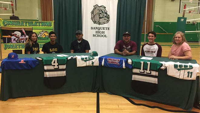 Banquete baseball players Jonathon Medina, left, and Joseph Gutierrez each signed with colleges on Tuesday.