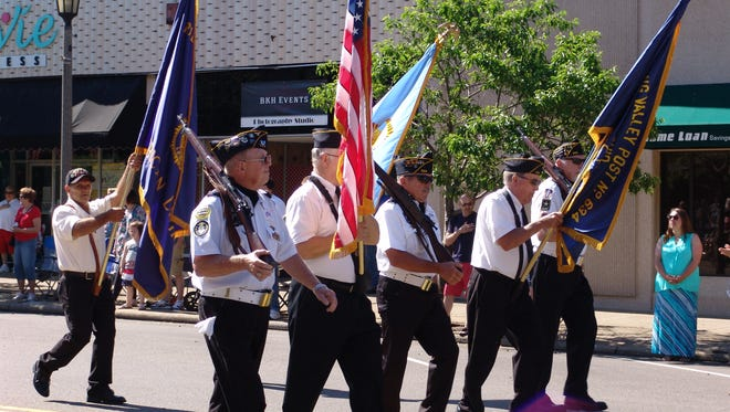 The Coshocton County Honor Guard marches in a previous Memorial Day parade. The parade has been canceled, but services will be held.