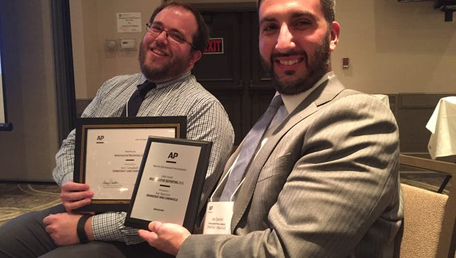 (Right,) USA TODAY Albany bureau chief Joe Spector and (left) correspondent Jon Campbell with their NYSAPA awards for Investigative Reporting awarded in Saratoga Springs on June 3. Spector won 1st place, Campbell won 3rd.