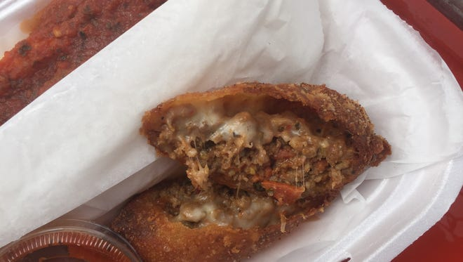 A stroll from Adena's Beef Stroll food truck: an egg roll filled with Italian meats.