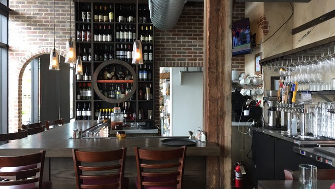 Cacciatore at Heller's Kitchen features old world Italy with dark wood and brick.