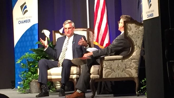 Indiana Gov. Eric Holcomb, left, answers a question from Evansville Mayor Lloyd Winnecke during a Lunch With the Governor program Monday, sponsored by the Southwest Indiana Chamber.