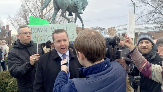 "Protesters shout as Virginia gubernatorial candidate Corey Stewart gives interviews to local television stations in February about his opposition to removing a Robert Lee statue from a Charlottesville, Virginia, park. ""I believe in protecting historical monuments,"" Stewart says. ""The KKK is a racist organization that has no place in Virginia."""