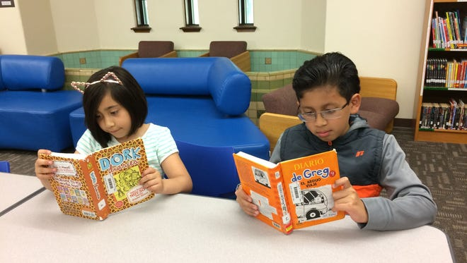Camila Magaña and Jair Rincon Simon utilize the bilingual library at Tank Elementary whenever possible.