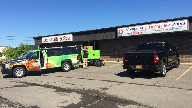 A building housing several businesses at 229 Vestal Parkway East was damaged in a fire.
