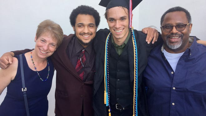 It took a village to raise this graduate. Sawyer with his friend, Sam Mosley, since he's known since preschool, and his parents, Lisa Schamus and Arch Mosley.
