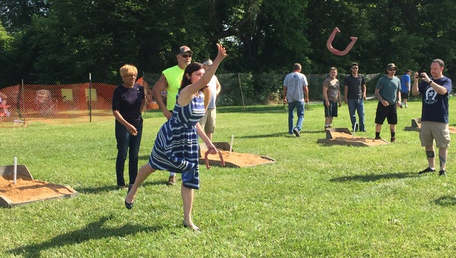 State Rep. Kristen Phillips-Hill, R-York Township, throws a horseshoe during Pitching 4 Patriots at Veterans Memorial Park on Saturday. Christopher Dornblaser photo.