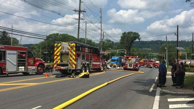 Emergency responders in Bridgewater at the scene of an overturned tractor-trailer Wednesday.