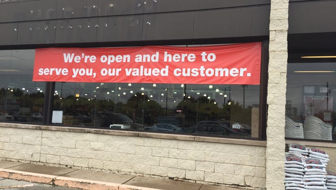 "A banner at the Marsh store in Broad Ripple reads ""We're open and here to serve you, our valued customer."" This is among 18 Marsh stores that will soon close."