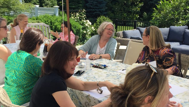 Women gather at the Montclair home of Lee Heh Margolies to discuss Impact100 Essex.