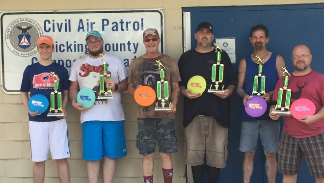 These were the top finishers Saturday in the Spring Fling disc golf tourney at River View Disc Golf Course in Newark's Everett Park. From left are Craig Hill and Michael Hughett of Zanesville (tied for second), Glen O'Bryan and Brandon Beavers from Lancaster (first), and John Dowling of Newark and Rob Gastineau from Granville (tied for second).