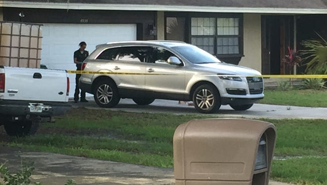 Deputies conduct an investigation at a home in Port St. John, where at least one person was found dead.
