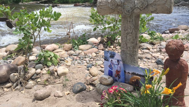 A memorial marks the spot near where 18-year-old Max Lopez died while floating on the Poudre River after passing over a low-head dam.