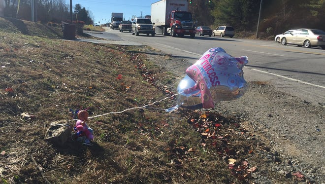 Balloons and a baby doll were set out near Fairview Road to honor two children who were killed by a motorist Dec. 1. Aurora Garcia, 72, had been crossing the street with Alexander Bautista-Gomez, 10, and Milena Alejandro-Bautista, 5, to get dinner at Subway when Elvin Jossue Hernandez, 20, hit them. Garcia survived the collision.