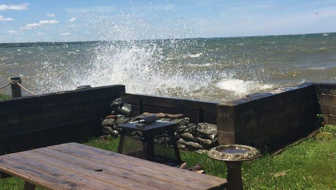 Waves pummel a breakwall in the Oklahoma Beach area of Webster in June.