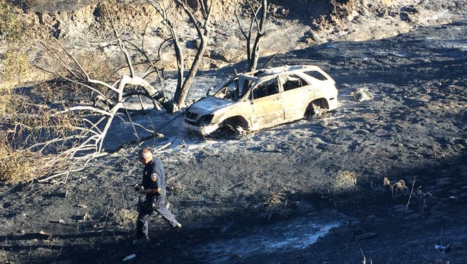 This car, seen destroyed in the Manzanita Fire, is the one that was involved in a solo crash that ignited the blaze, authorities said. The photograph taken Tuesday, June 27, 2017, shows a charred area on the west side of Highway 79.