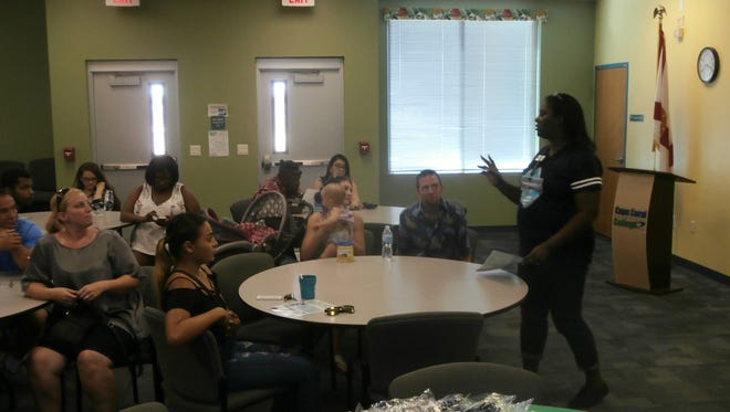 Melody Allen, admissions specialist of Cape Coral Technical College, speaks to some of the attendees of a recent open house.