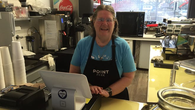 Mary Ellen Cann operates the cash register at Point Perk, one of four businesses operated by The Point Arc that serves individuals with intellectual and developmental disabilities.