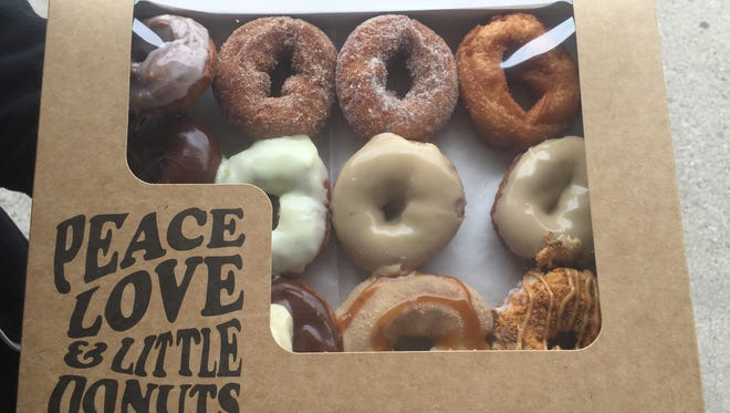 A dozen doughnuts from Peace, Love and Little Donuts in Fort Collins.