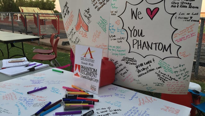 Hundreds signed posters for Phantom Regiment Drum and Bugle Corp after its bus driver died and eight staff members were injured in a crash near Quartzsite at 4 a.m. on Monday, July 3, 2017.