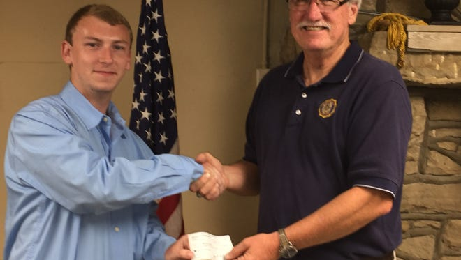 Pictured on the right is American Legion Post # 48 Vice Commander Lark Buckman presenting Brandon Sampson a scholarship check. Brandon is the son of Jim and Marie Duckworth and plans to attend Henderson Community College to prepare for a career in law enforcement.