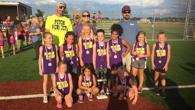The Pitch Perfect softball team placed first in the 8 years old and younger, National League Division of the Sunrise Optimist Girls Softball League. In the top row are coaches Justin Boone, Michelle Boone and Chris Reese. In the middle row are Sophie Reese, Alora Ramirez, Lily Dishman, Kendyl Thomas, Janae Stewart, Karlie Boone and Riley Whitley. Pictured in the bottom row are Lindey McCord, Daniella Ramirez and Kendall Snodgrass. Not pictured are Parker Reed and Katelyn Camp.
