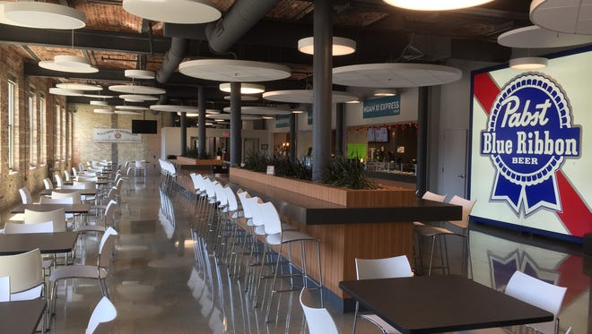 Ashley's Que Grill & Bistro will open within the next two weeks at the food court in the Eleven25 at Pabst apartment building, 1125 N. 9th St.