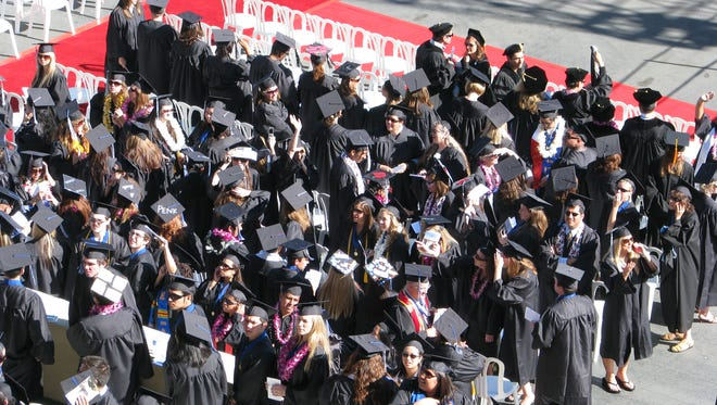 Graduates are shown at CSU San Marcos. This year the California Legislature made some progress in helping ease the costs for college.