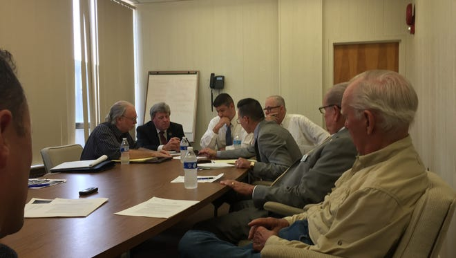 The Millville Industrial Commission in this file photo meets with Delaware River & Bay Authority officials about further development of the municipal airport. Members are unpaid appointees, typically with business and government backgrounds, who do research and policy recommendations for municipal government.