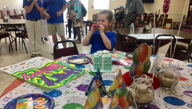 Greer Community Ministries surprised Ivey Tapp with a birthday cake, card, and other goodies after the 6-year-old and her parents came by to deliver the loads of canned goods and monetary donations collected for the organization in her honor.