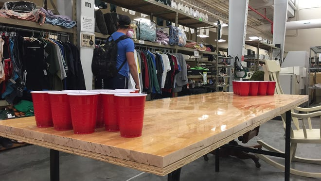 A section of the former Breslin Center practice floor turned into a pong table was on display Friday, July 14 inside the MSU Surplus Store. The store sold pieces of the practice floor to nearly 400 people who came out Friday.