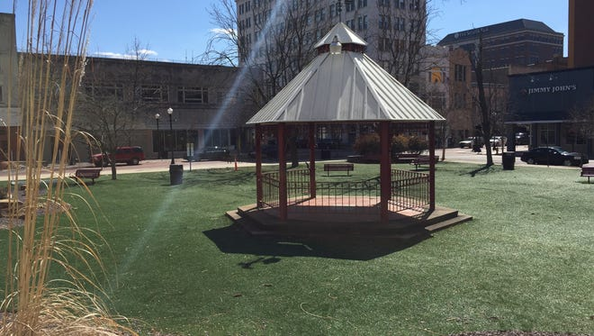 The artificial turf-covered park on Main Street is an example of Downtown areas that could be enhanced by using a Economic Improvement District, advocates for the EID said.