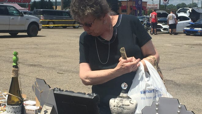 A woman looks at items for sale on Saturday at a fundraiser benefiting three local groups.