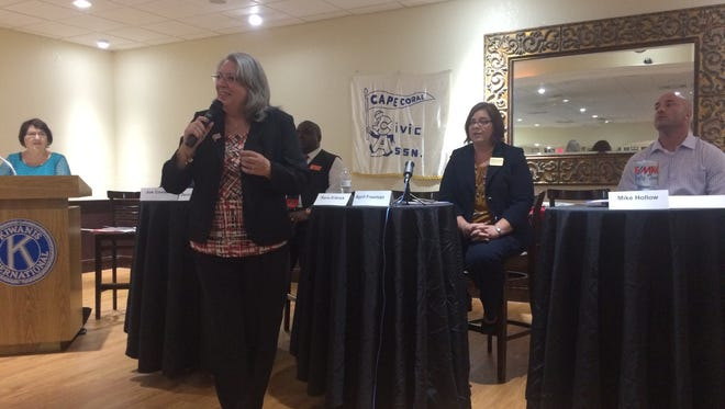 Mayoral Candidate Rana Erbrick addresses the candidate forum as candidates Derrick Donnell, April Freeman, and Michael Hollow look on. The other mayoral candidates on stage with them are Joe Coviello and Dan Sheppard. Mayoral candidate Kevin Koch did not attend the forum