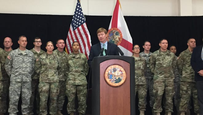 "Agriculture Commissioner Adam Putnam called on the National Guard for back up when he called a news conference to announce his office had ""expedited"" 82,000 concealed weapons permit applications from Guardsmen."