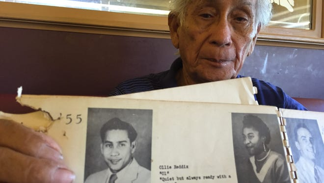 World War II survivor and Korean War veteran George C. Perez, 86, shows a termite-infested yearbook of E.R. Snyder Continuation High School in San Diego, California, which has his photo as a member of the Class of 1955. He wasn't able to get his actual diploma because he got married shortly before graduation. That was his second attempt to get his diploma; the first one was in 1950 at George Washington High School on Guam.